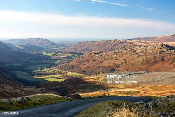 scenic view of mountains against sky - lake windermere stock pictures, royalty-free photos & images