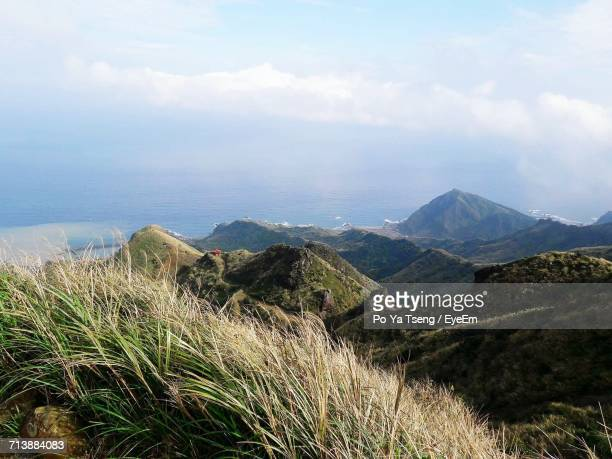 scenic view of mountains against sky - poya day stock pictures, royalty-free photos & images