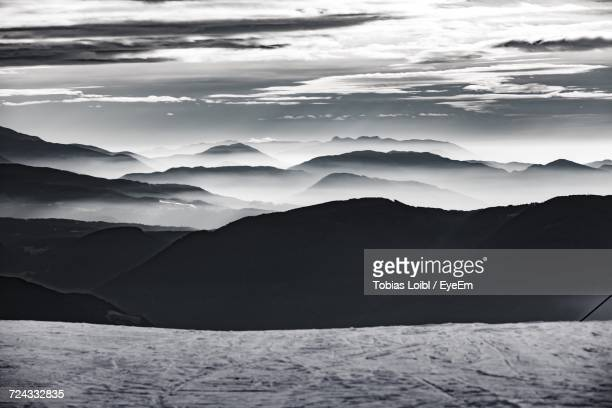 scenic view of mountains against sky - loibl stock-fotos und bilder