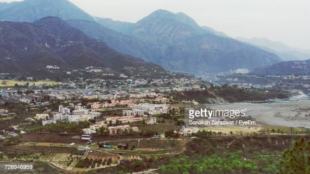 scenic view of mountains against sky - kashmir valley stock photos and pictures