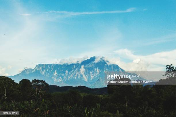 scenic view of mountains against sky - muslimgirlcollection stock pictures, royalty-free photos & images