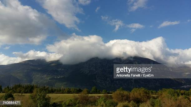 scenic view of mountains against sky - antonella stock photos and pictures