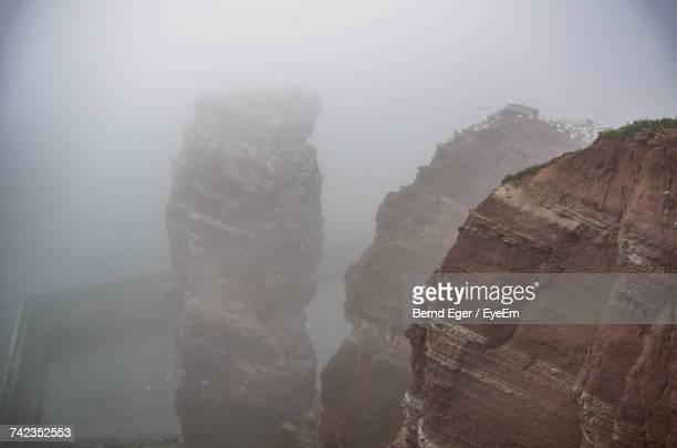 scenic view of mountains against sky - helgoland stock pictures, royalty-free photos & images