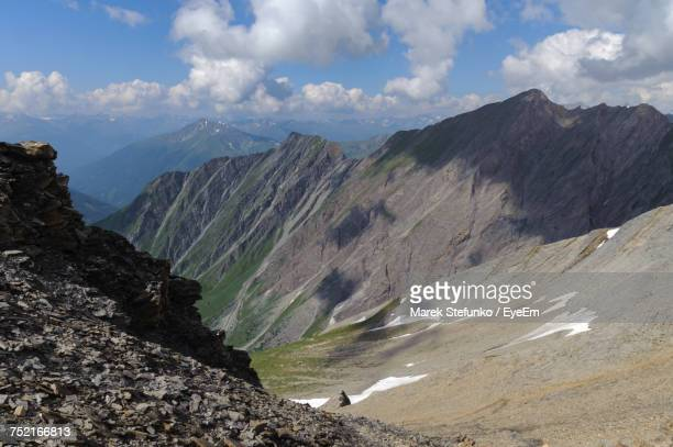 scenic view of mountains against sky - marek stefunko stock photos and pictures