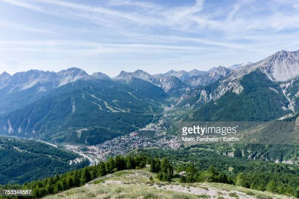 scenic view of mountains against sky - bardonecchia stock photos and pictures