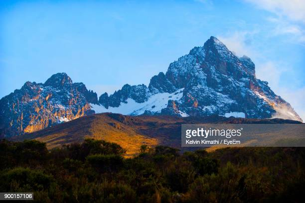 scenic view of mountains against sky - kilimanjaro stock photos and pictures