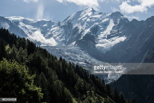 scenic view of mountains against sky - rhone alpes stock photos and pictures