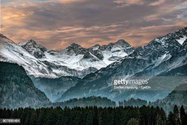 scenic view of mountains against sky - oberstdorf stock pictures, royalty-free photos & images