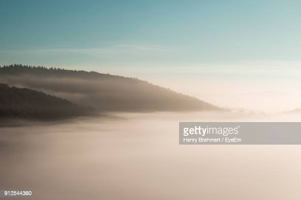 scenic view of mountains against sky - moseltal stock-fotos und bilder
