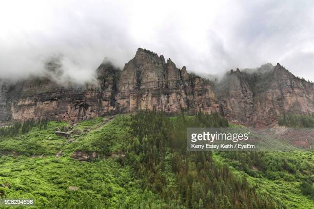 scenic view of mountains against sky - kerry estey keith stock photos and pictures
