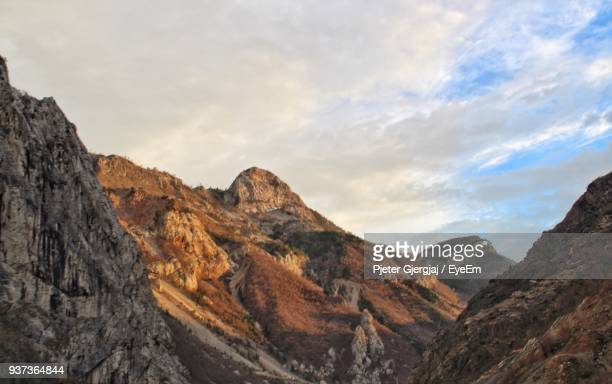scenic view of mountains against sky - albania stock-fotos und bilder
