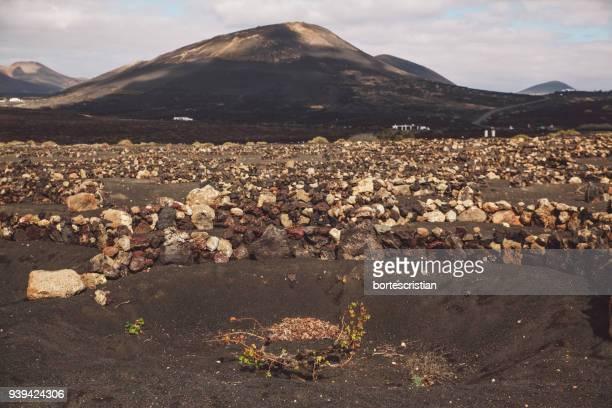 scenic view of mountains against sky - bortes photos et images de collection