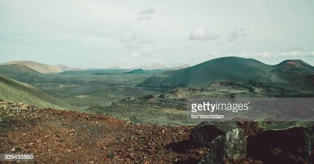 scenic view of mountains against sky - bortes fotografías e imágenes de stock