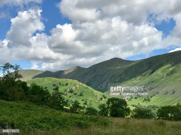 scenic view of mountains against sky - ambleside stock photos and pictures