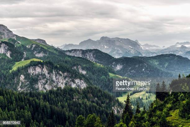 scenic view of mountains against sky - berchtesgaden stock-fotos und bilder