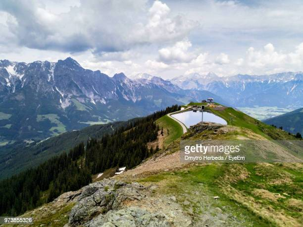 scenic view of mountains against sky - leogang stock pictures, royalty-free photos & images