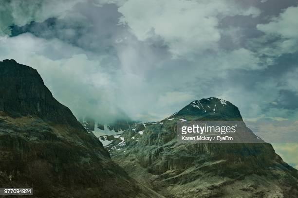 scenic view of mountains against sky - karen mckay stock photos and pictures