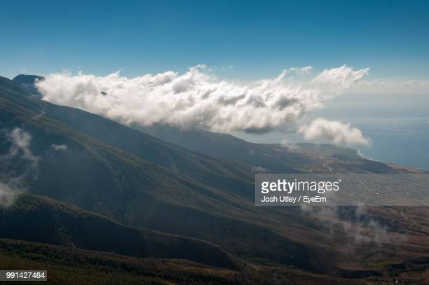 scenic view of mountains against sky - josh utley stock pictures, royalty-free photos & images