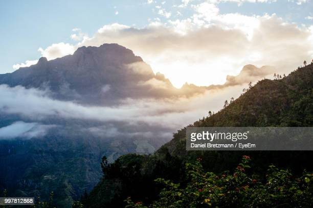 scenic view of mountains against sky - フランス海外領 ストックフォトと画像