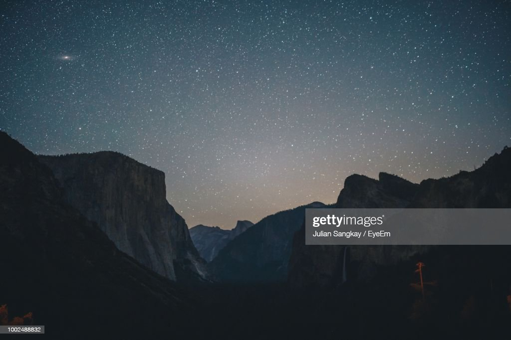 Scenic View Of Mountains Against Star Field At Night : Stock Photo