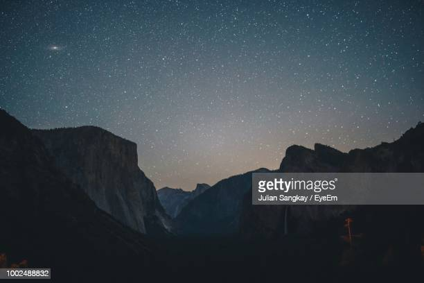 scenic view of mountains against star field at night - julian california stock photos and pictures