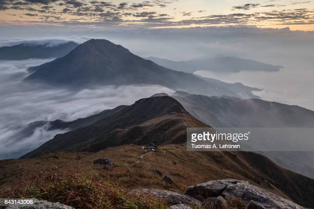 Scenic view of mountains and coastline from the Lantau Peak (the second highest peak in Hong Kong, China (934m)) at dawn.