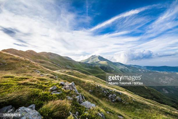 scenic view of mountains and dramatic sky - modena stock pictures, royalty-free photos & images