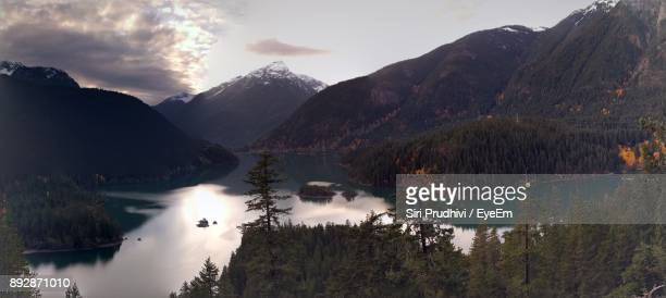 Scenic View Of Mountains And Lake Against Sky