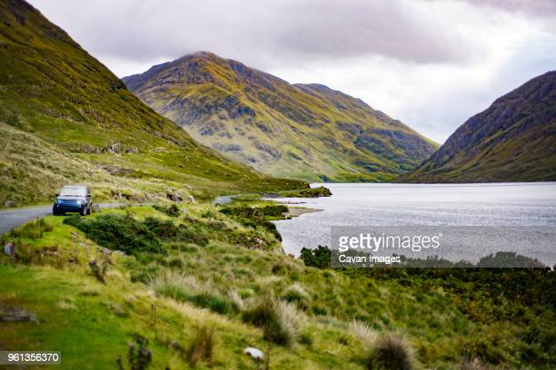 scenic view of mountains and lake - irlande photos et images de collection