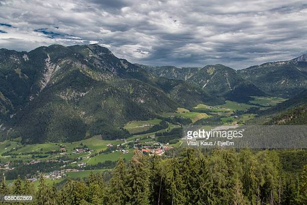 Scenic View Of Mountains And Landscape Against Cloudy Sky