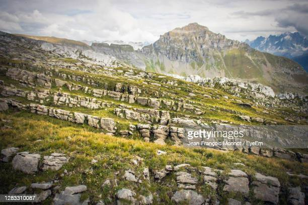 scenic view of mountains and landscape against sky - sallanches stock pictures, royalty-free photos & images