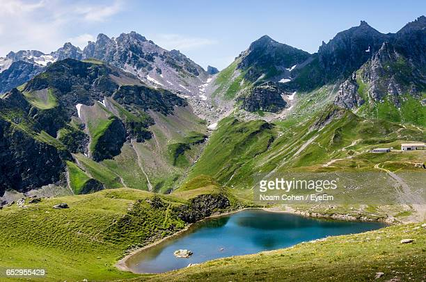 scenic view of mountains and pond against sky - bad ragaz stock pictures, royalty-free photos & images