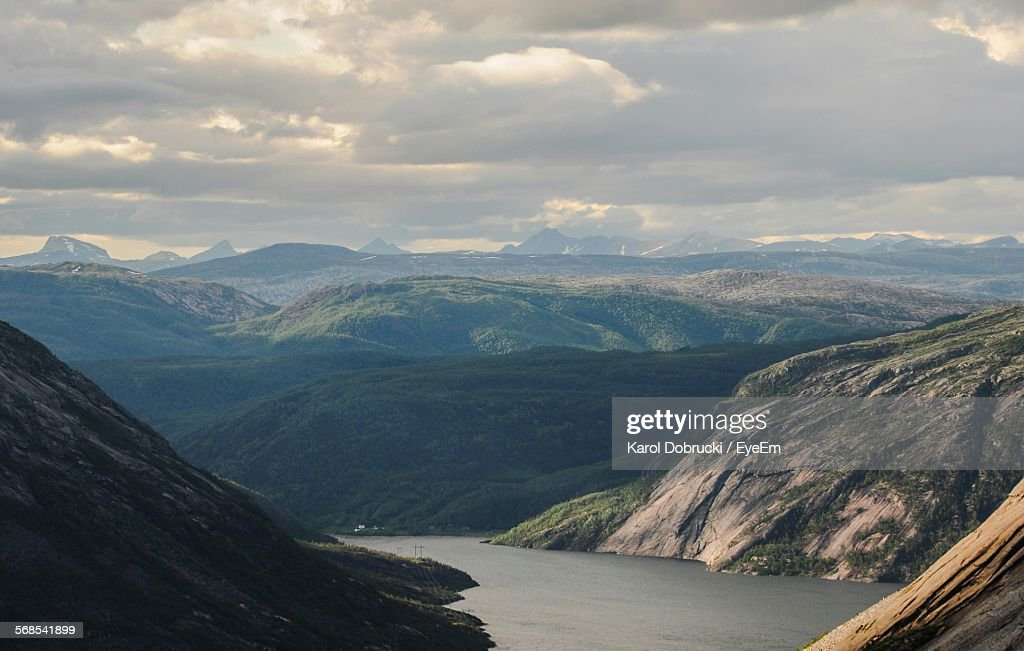Scenic View Of Mountains And River Against Cloudy Sky : Stock Photo
