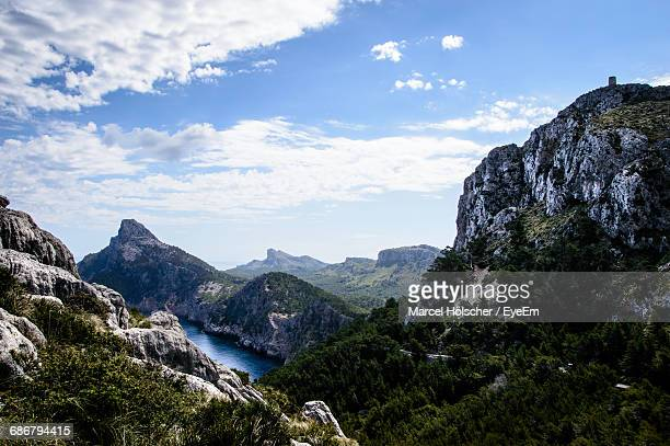 Scenic View Of Mountains And River Against Sky