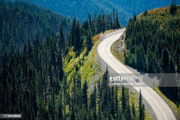 scenic view of mountains and road against sky. olympic national park, usa. - カスケード山脈 ストックフォトと画像