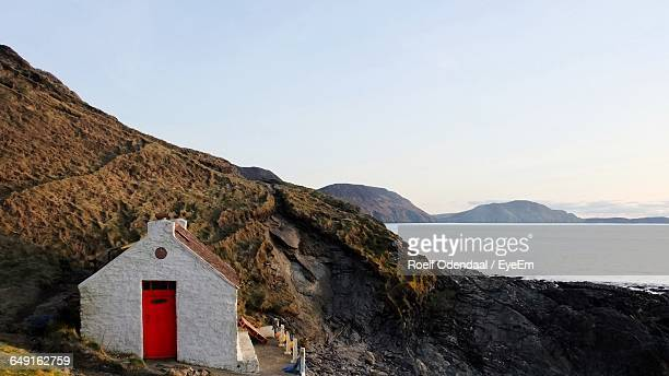 scenic view of mountains and sea against clear sky - isle of man stock pictures, royalty-free photos & images
