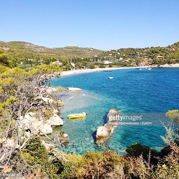 scenic view of mountains and sea against clear sky - spetses stock pictures, royalty-free photos & images