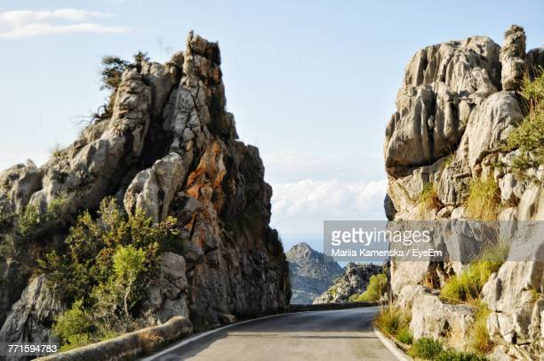 scenic view of mountains and sea against sky - rock wall stock pictures, royalty-free photos & images