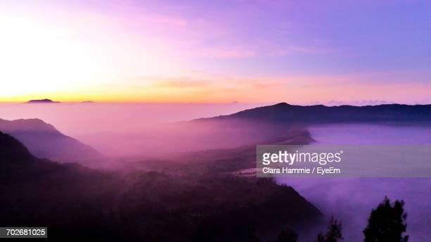 scenic view of mountains at sunset - twilight stock pictures, royalty-free photos & images