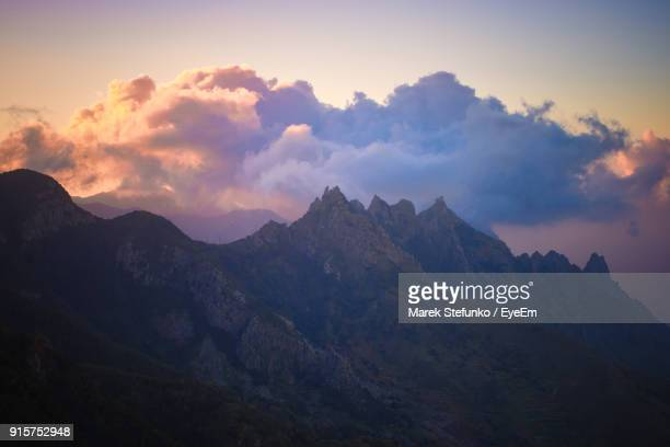 scenic view of mountains at sunset - marek stefunko stock photos and pictures