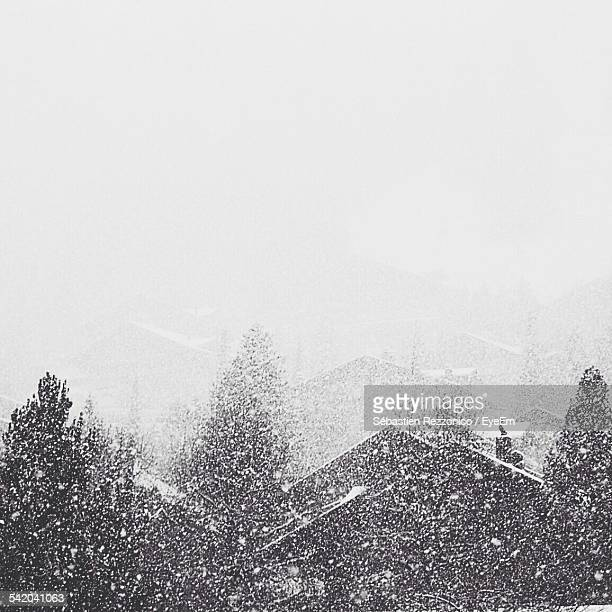 Scenic View Of Mountains During Snowfall