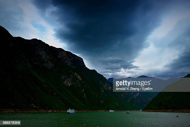 Scenic View Of Mountains In Riverbank Of Yangtze River At Dusk