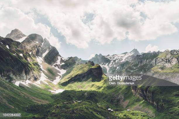 scenic view of mountains in switzerland - mountain stock pictures, royalty-free photos & images
