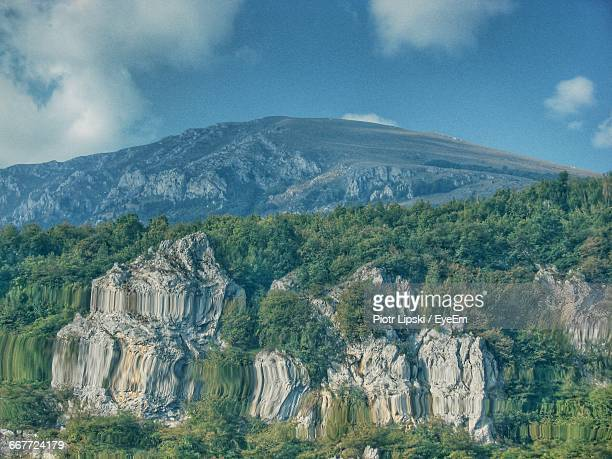 scenic view of mountains reflecting on lake ohrid - lake ohrid stock photos and pictures