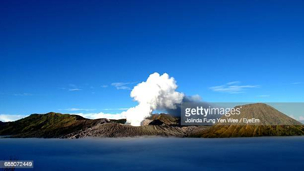 scenic view of mt bromo against clear blue sky - bromo crater stock photos and pictures