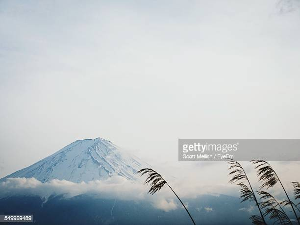 scenic view of mt fuji against sky - stratovolcano stock photos and pictures