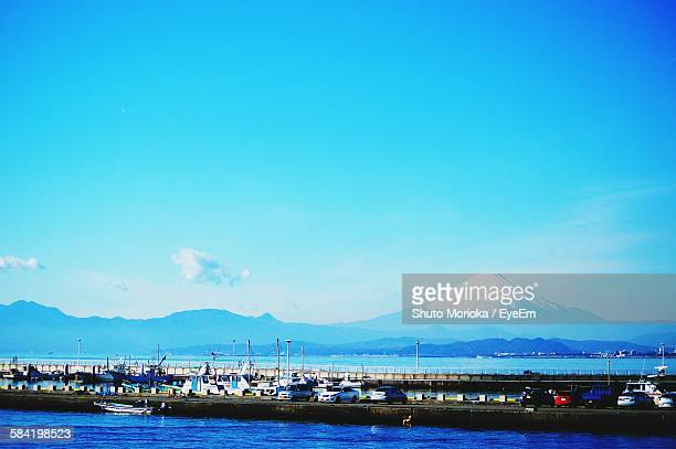 Scenic View Of Mt Fuji By Sea Against Clear Blue Sky