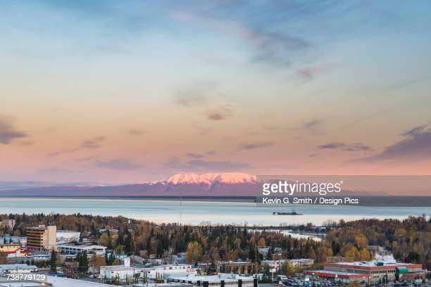 scenic view of mt. susitna at sunset with anchorage and cook inlet in the foreground, southcentral alaska, usa - mt. susitna stock pictures, royalty-free photos & images