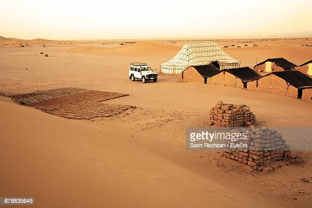 Scenic View Of Mud Huts In The Desert