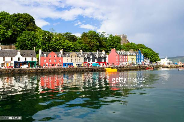 scenic view of multi colored buildings by trees against sky - scotland stock pictures, royalty-free photos & images